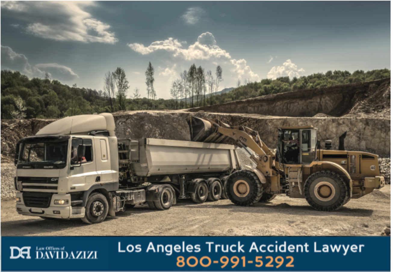 Construction Front Loader Into Dump Truck - Law Offices of David Azizi