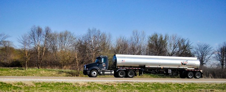 A large tanker truck seen in profile on the road.