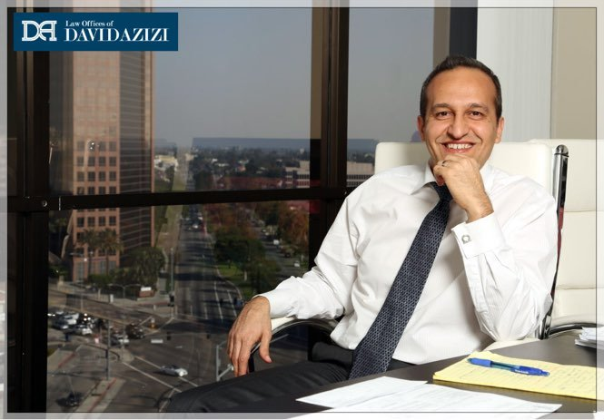 Attorney David Azizi at his desk